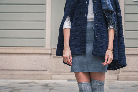 miniskirt: Detail of a beautiful girl with miniskirt posing in the city streets