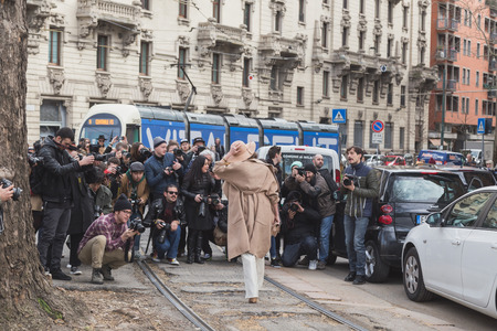 gucci: MILAN, ITALY - FEBRUARY 25: People gather outside Gucci fashion show building for Milan Womens Fashion Week on FEBRUARY 25, 2015  in Milan.