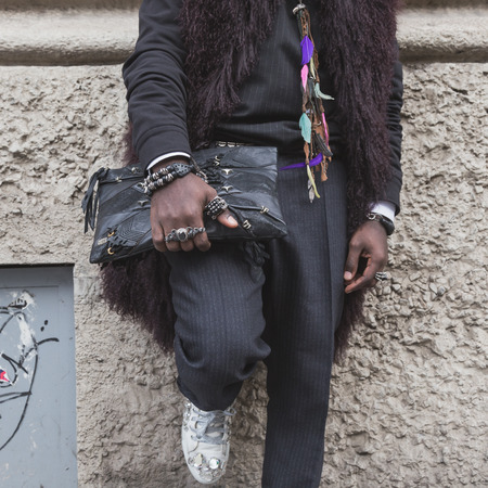 gucci: MILAN, ITALY - FEBRUARY 25: Detail of a man with bag outside Gucci fashion show building for Milan Womens Fashion Week on FEBRUARY 25, 2015  in Milan. Editorial