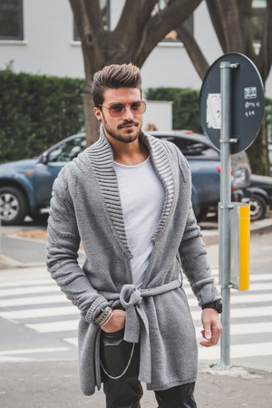 mariano: MILAN, ITALY - FEBRUARY 27: Man poses outside Armani fashion show building for Milan Womens Fashion Week on FEBRUARY 27, 2015  in Milan.