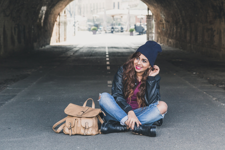 middle eastern: Beautiful Middle Eastern girl with long hair posing in a tunnel Stock Photo