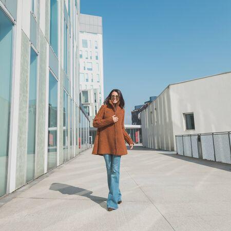context: Beautiful girl with long hair posing in an urban context