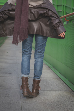 foot bridges: Detail of a young woman with biker boots posing on a bridge