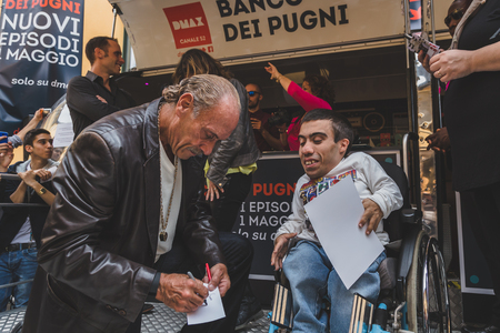 hardcore: MILAN, ITALY - APRIL 18: Les Gold of the tv series Hardcore Pawn autographs a picture for a guy on wheelchair at Fuorisalone, important and interesting events all around the town during Milan Design Week on APRIL 18, 2015 in Milan.