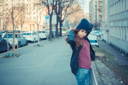 middle eastern clothing: Beautiful Middle Eastern girl with long hair posing in an urban context Stock Photo