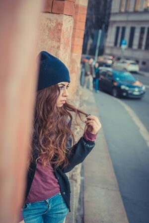 middle eastern: Beautiful Middle Eastern girl with long hair posing in an urban context Stock Photo