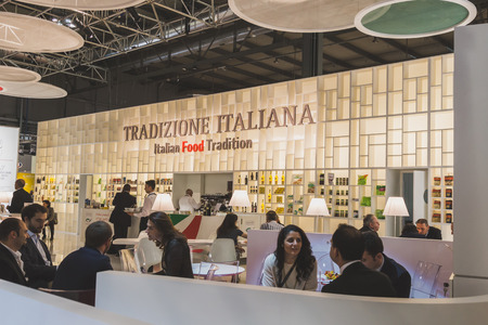 4 people: MILAN, ITALY - MAY 4: People visit Tuttofood, world food exhibition on MAY 4, 2015 in Milan.