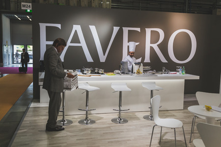 4 people: MILAN, ITALY - MAY 4: People visiting Tuttofood, world food exhibition on MAY 4, 2015 in Milan. Editorial