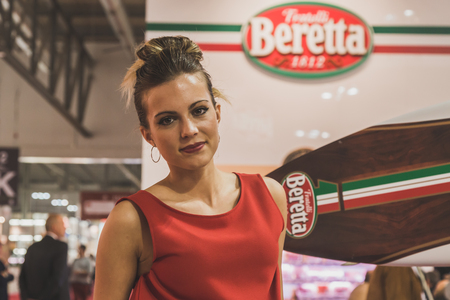 culinary tourism: MILAN, ITALY - MAY 4: Pretty girl working at Tuttofood, world food exhibition on MAY 4, 2015 in Milan. Editorial