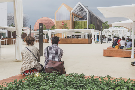 4 people: MILAN, ITALY - MAY 4: People visit Expo, universal exposition on the theme of food on MAY 4, 2015 in Milan. Editorial