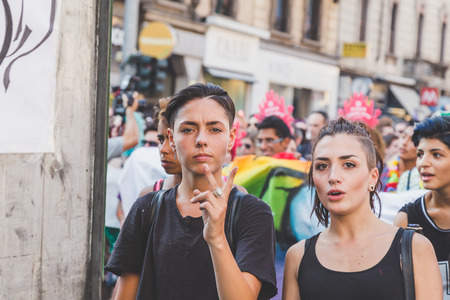 bisexual women: MILAN, ITALY - JUNE 27: People at gay pride parade in Milan JUNE 27, 2015. Thousands of people march in the city streets for the annual gay pride parade, claiming equality and legal rights.