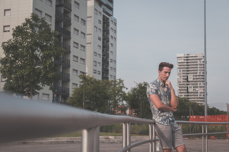 short sleeve: Young handsome man with short hair wearing a short sleeve shirt and posing in an urban context Stock Photo