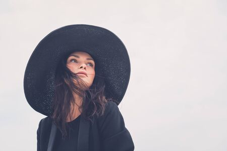 gorgeous: Gorgeous young brunette with hat posing in an urban context Stock Photo