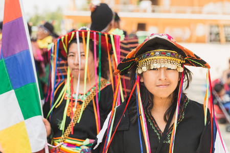 6 people: MILAN, ITALY - AUGUST 6: People in their traditional dresses take part in the Bolivia National Day at Expo, universal exposition on the theme of food on AUGUST 6, 2015 in Milan.