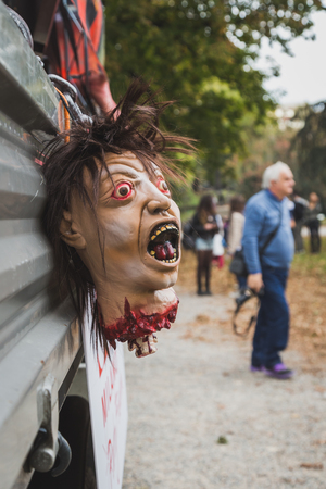beheaded: MILAN, ITALY - OCTOBER 25: Detail of a decapitated head at the Zombie Walk, social event in the city streets just before Halloween on OCTOBER 25, 2014 in Milan.