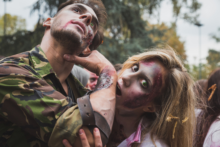 cannibal: MILAN, ITALY - OCTOBER 25: People take part in the Zombie Walk, social event in the city streets just before Halloween on OCTOBER 25, 2014 in Milan.