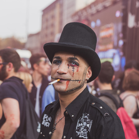 stovepipe hat: MILAN, ITALY - OCTOBER 10: People take part in the Zombie Walk, social event in the city streets just before Halloween on OCTOBER 10, 2015 in Milan.
