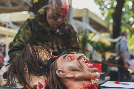 beheaded: MILAN, ITALY - OCTOBER 10: People take part in the Zombie Walk, social event in the city streets just before Halloween on OCTOBER 10, 2015 in Milan.
