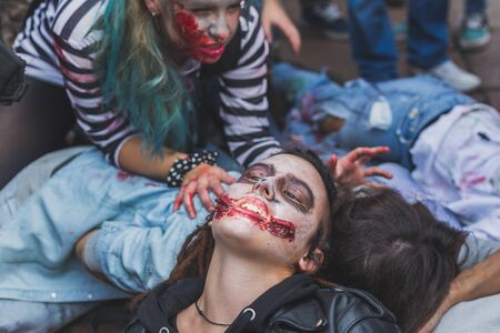 gore: MILAN, ITALY - OCTOBER 10: People take part in the Zombie Walk, social event in the city streets just before Halloween on OCTOBER 10, 2015 in Milan.
