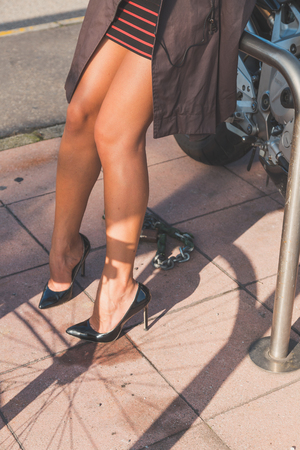 long feet: Detail of a beautiful young woman with skirt posing in an urban context Stock Photo