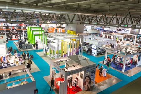 MILAN, ITALY - OCTOBER 16: Top view of booths and people at Viscom, international trade fair and conference on visual communication and event services on OCTOBER 16, 2015 in Milan. Editorial