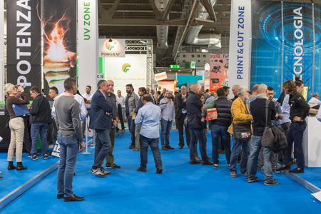 exhibition crowd: MILAN, ITALY - OCTOBER 16: People visit Viscom, international trade fair and conference on visual communication and event services on OCTOBER 16, 2015 in Milan.