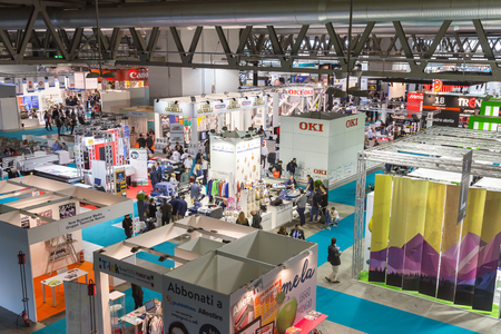 exhibition crowd: MILAN, ITALY - OCTOBER 16: Top view of booths and people at Viscom, international trade fair and conference on visual communication and event services on OCTOBER 16, 2015 in Milan. Editorial