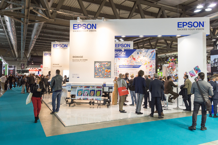 MILAN, ITALY - OCTOBER 16: People visit Epson stand at Viscom, international trade fair and conference on visual communication and event services on OCTOBER 16, 2015 in Milan.
