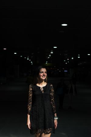 woman alone: Portrait ofa young beautiful woman with long hair posing in an urban context Stock Photo