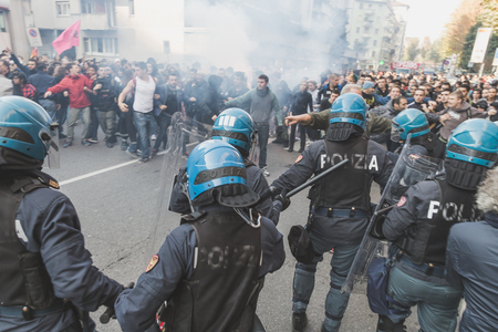 demonstrators: MILAN, ITALY - NOVEMBER 13: Students confront police during a march in the city streets to protest agaist the public school management on NOVEMBER 13, 2015 in Milan. Editorial