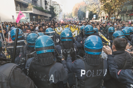 occupy movement: MILAN, ITALY - NOVEMBER 13: Students confront police during a march in the city streets to protest agaist the public school management on NOVEMBER 13, 2015 in Milan. Editorial