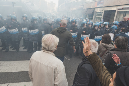 occupy movement: MILAN, ITALY - NOVEMBER 13: People confront riot police during a march in the city streets to protest agaist the public school management on NOVEMBER 13, 2015 in Milan. Editorial