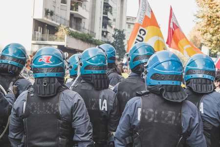 occupy movement: MILAN, ITALY - NOVEMBER 13: Riot police confronting the students during a march in the city streets to protest agaist the public school management on NOVEMBER 13, 2015 in Milan. Editorial
