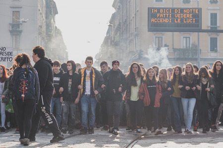demonstrators: MILAN, ITALY - NOVEMBER 13: Thousands of students and teachers march in the city streets to protest agaist the public school management on NOVEMBER 13, 2015 in Milan. Editorial