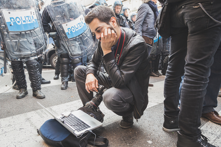 occupy movement: MILAN, ITALY - NOVEMBER 13: Photographer at work during a protest agaist the public school management on NOVEMBER 13, 2015 in Milan.