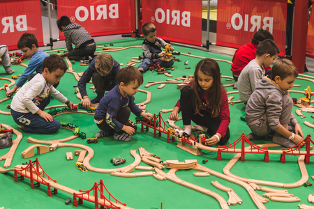 fair play: MILAN, ITALY - NOVEMBER 20: Children play at G come giocare, trade fair dedicated to games, toys and children on NOVEMBER 20, 2015 in Milan.