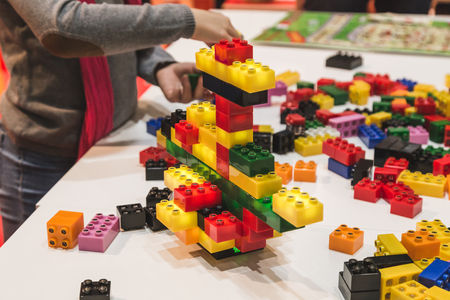 children play: MILAN, ITALY - NOVEMBER 20: Children play at G come giocare, trade fair dedicated to games, toys and children on NOVEMBER 20, 2015 in Milan.
