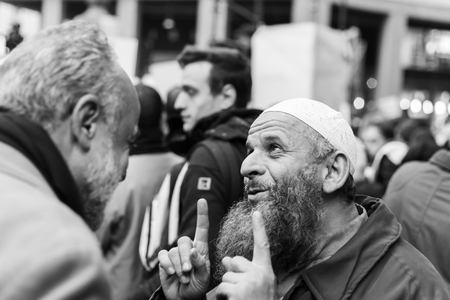 demonstrators: MILAN, ITALY - NOVEMBER 21: The Muslim Community demonstrates against every kind of terrorism in the name of Islamic religion on NOVEMBER 21, 2015 in Milan.