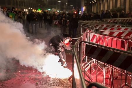 demonstrators: MILAN, ITALY - DECEMBER 12: Kurdish demonstrators protest in front of the Turkish Consulate on DECEMBER 12, 2015 in Milan.
