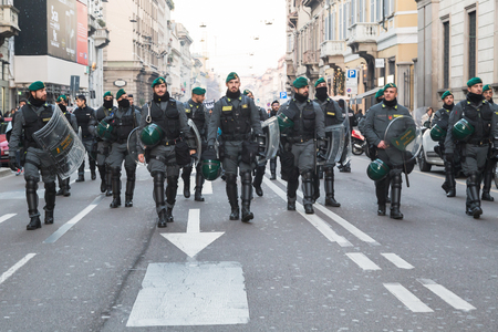 repression: MILAN, ITALY - DECEMBER 12: Riot police follow Kurdish demonstrators on DECEMBER 12, 2015 in Milan.