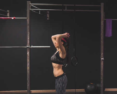 strenght: Beautiful young girl doing workout in the gym. Concept of health and fitness.