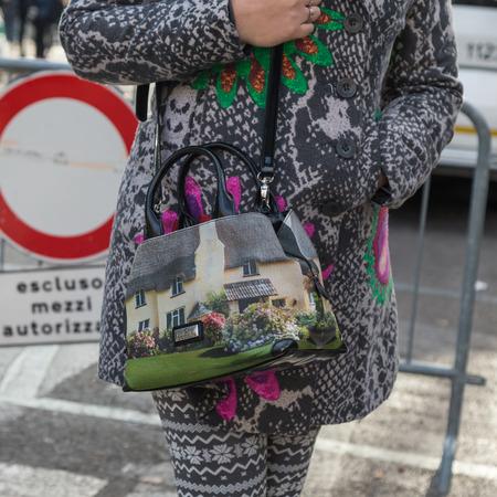 mens fashion: MILAN, ITALY - JANUARY 18: Detail of bag outside Armani fashion show building for Milan Mens Fashion Week on JANUARY 18, 2016 in Milan.