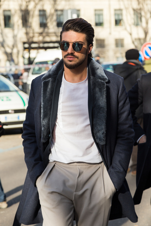 mariano: MILAN, ITALY - JANUARY 18: People gather outside Armani fashion show building for Milan Mens Fashion Week on JANUARY 18, 2016 in Milan.