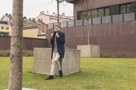 handsome boy: Young handsome man posing in an urban context Stock Photo