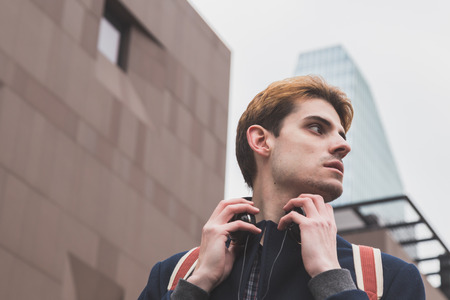 boy alone: Young handsome man posing in an urban context Stock Photo