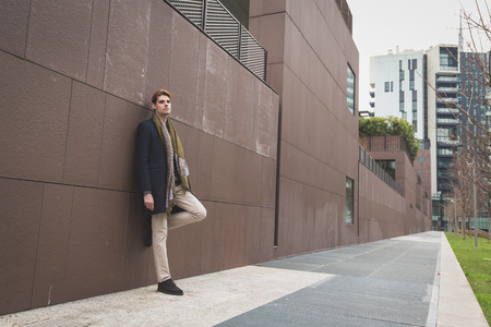 sad man alone: Young handsome man posing in an urban context Stock Photo