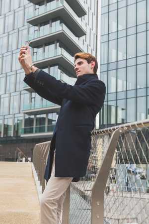 narcissism: Young handsome man posing in an urban context Stock Photo