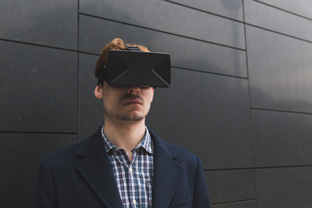 Young handsome man wearing a virtual reality headset