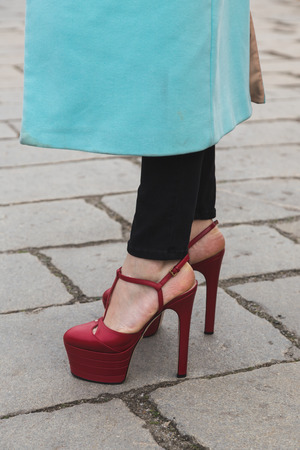 gucci: MILAN, ITALY - FEBRUARY 24: Detail of shoes outside Gucci fashion show building for Milan Womens Fashion Week on FEBRUARY 24, 2016 in Milan. Editorial