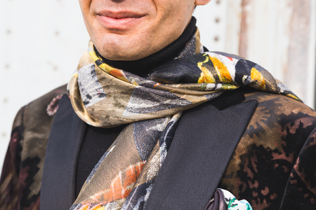 gucci: MILAN, ITALY - FEBRUARY 24: Detail of Etro jacket outside Gucci fashion show building for Milan Womens Fashion Week on FEBRUARY 24, 2016 in Milan.